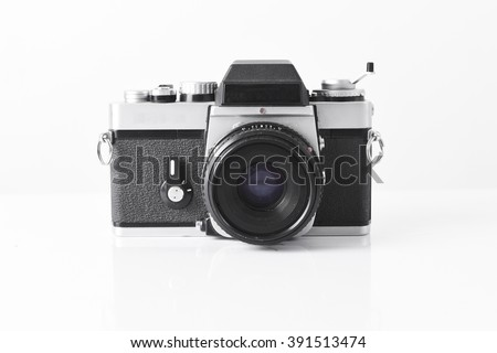 Old rangefinder vintage camera  isolated on white background,retro photo camera - stock photo