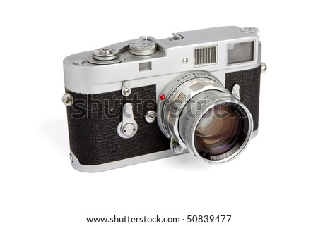 Old rangefinder vintage camera on white background