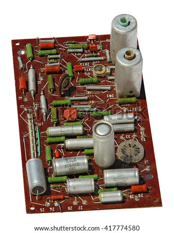 old rarity radio, tv board with electronic components, printed circuit board, resistor, capacitor, resistance, FET - stock photo
