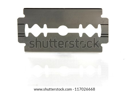 old razor on white - stock photo
