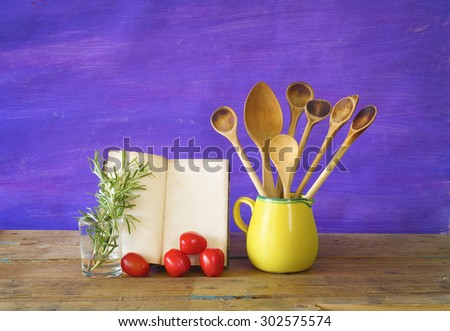 old recipe book, wooden spoons,food ingredients, cooking concept, free copy space - stock photo