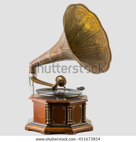 Old record players take on the white background. - stock photo