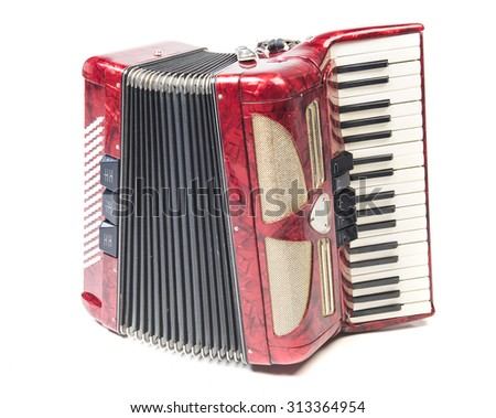 Old red accordion isolated on a white background - stock photo