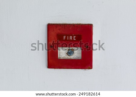 Old red box fire alarm  on cement wall