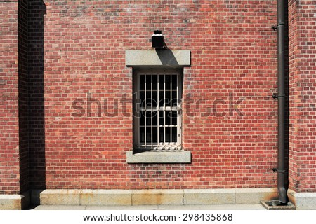 Old red brick building or factory with windows - stock photo