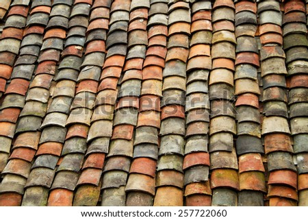 Old red brick roof tiles from north of Vietnam (H'mong house). - stock photo