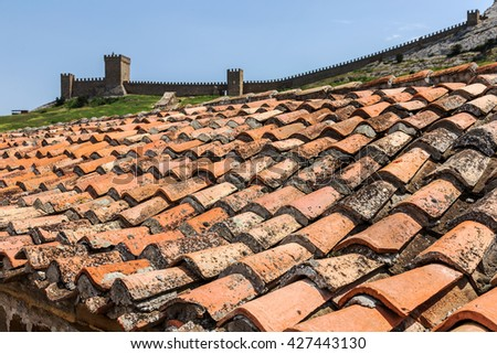 Old red brick tiles. Background of old red tiles. Geometric retro background old red ceramic tiles - stock photo