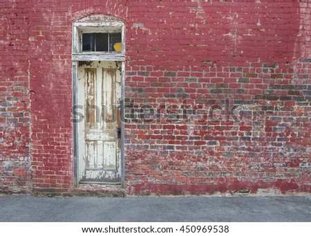 old red brick wall white door background - stock photo