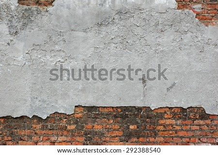 Old Red Brick Wall With Damaged Grey Plaster Abstract Horizontal Background Texture For Text Or Image - stock photo