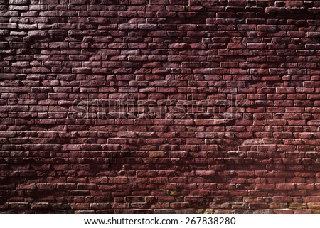 Old Red Brick Wall with Sunlight and Shadows - stock photo