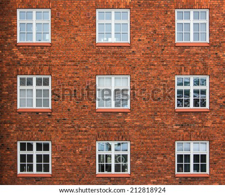 Old red brick wall with windows in Helsinki, Finland - stock photo