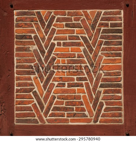 Old red brick wall with wooden beams as texture or background. Architectural detail. - stock photo