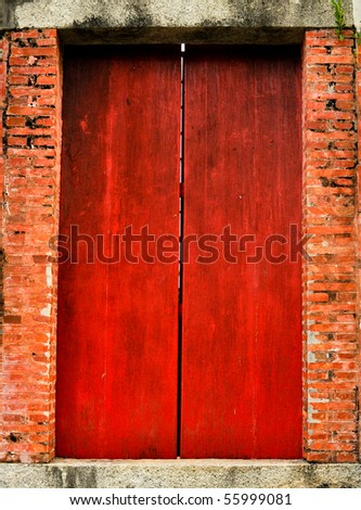 Old red doors : Doors is Chinese style - stock photo