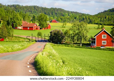old red farm houses set in a rural landscape and nature - stock photo