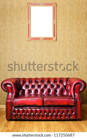 Old Red Genuine Leather Sofa Near The Wall