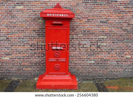 Old red mailbox in Amsterdam, Netherlands - stock photo