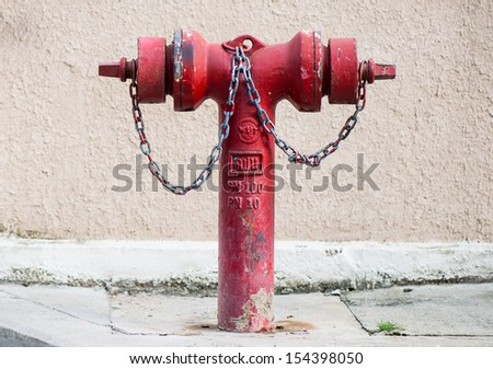 old red metallic fire hydrant or Fire Department Connection on street - stock photo