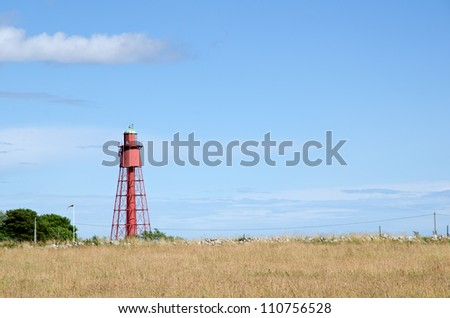 Old red metallic lighthouse