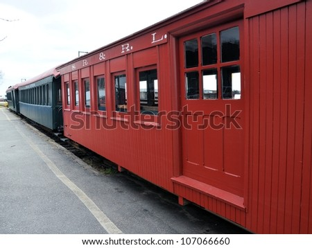 Old red train cars at a railroad stop. - stock photo