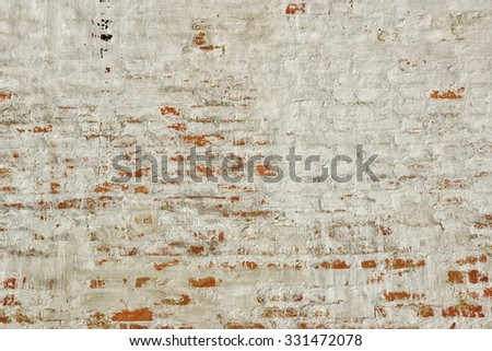 Old Red Whitewashed Brick Wall With Damaged Plaster Background Texture