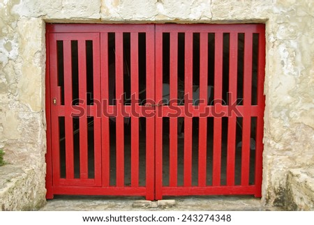 Old Red Wooden Door of a boat shelter in the Mediterranean Sea (Majorca) - stock photo