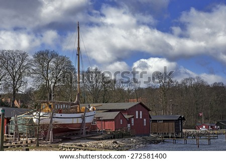 Old red wooden shipyard in Middelfart, Denmark - Close to Little Belt. - stock photo