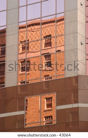 Old reflected in the new - stock photo