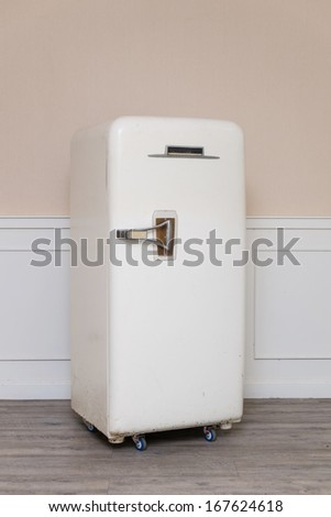 old refrigerator in cozy room - stock photo