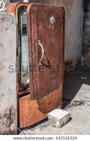 Old refrigerator rusty and abandoned - stock photo