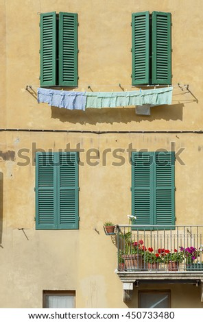 Old residential building in Siena, Tuscany, Italy