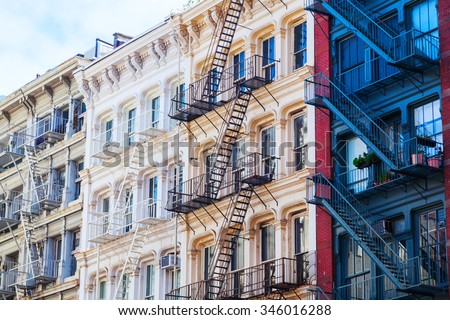 old residential buildings with fire escape stairs in Soho, New York City - stock photo