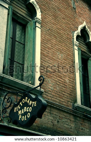 Old restaurant sign in Venice in a street - stock photo