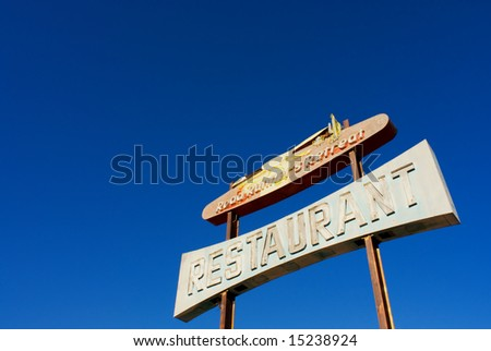 Old restaurant sign on rout 66 in amboy ca - stock photo