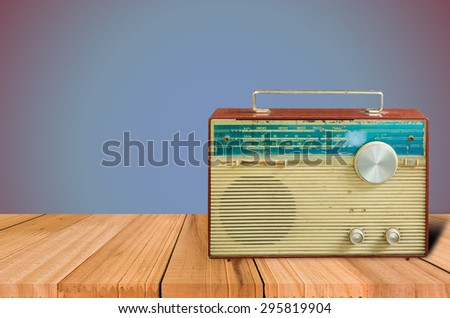 old retro and vintage radio on table blue background. - stock photo