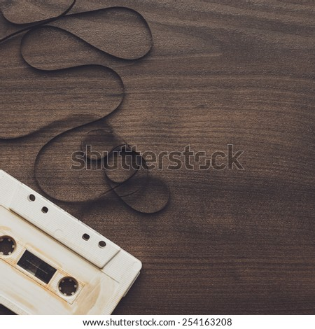 old retro audio cassette over wooden background