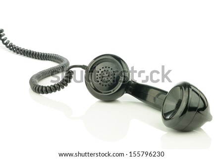 Old retro bakelite earphone. On a white background - stock photo