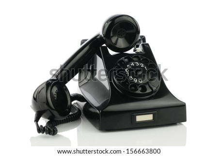 Old retro bakelite telephone. On a white background - stock photo