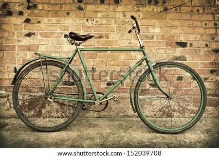 Old retro bicycle against brick wall