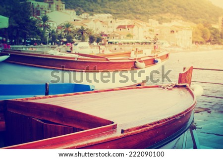 Old retro boats on the old town background in vintage style - stock photo
