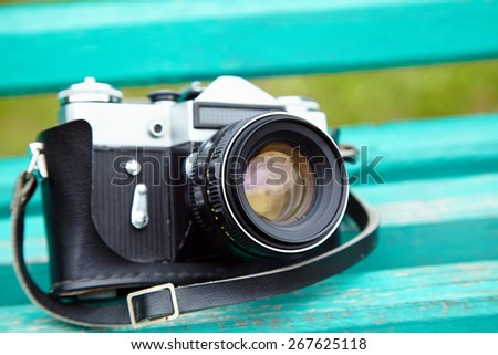 Old retro camera on vintage wooden boards. film camera - stock photo