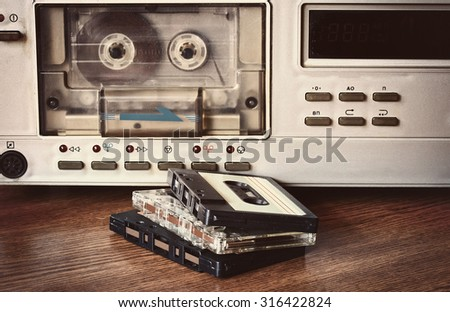 old retro cassette recorder stands on a table - stock photo
