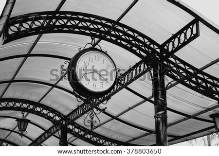 old retro clock of one central station in b/w - stock photo