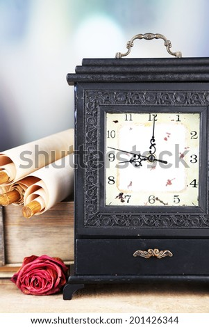 Old retro clock on abstract background - stock photo