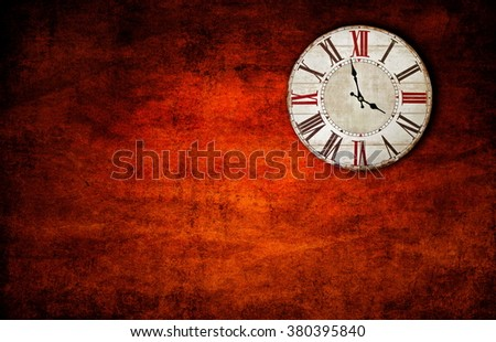 old retro clock on the wall - stock photo