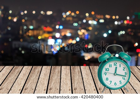 old retro clock on wood , abstract background to time for night vacation concept. - stock photo