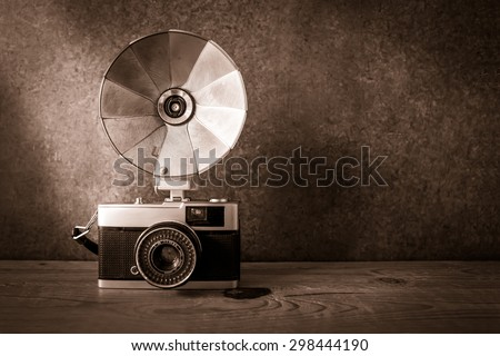 Old retro compact camera with flash - stock photo