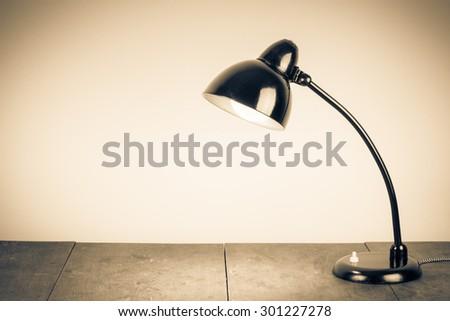 Old retro desk lamp. Vintage style sepia photo - stock photo