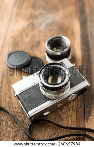 Old retro Film camera on wooden background that had been popular in the past - stock photo