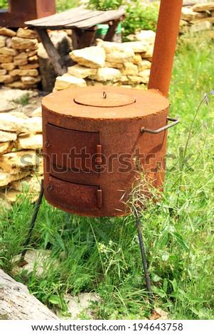 Old retro oven, outdoors - stock photo