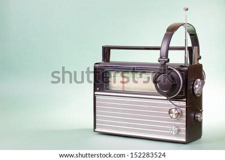 Old retro radio and headphones conceptual photo for vintage background - stock photo